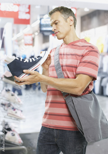 Man looking at shoes in store