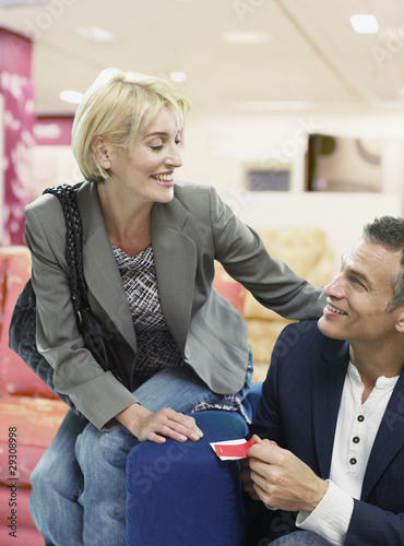 Couple looking at couches in store