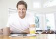 Man in kitchen with newspaper
