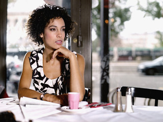 Woman in restaurant with paperwork