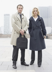 Two businesspeople standing outdoors