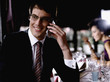 Businessman in restaurant on cellular phone