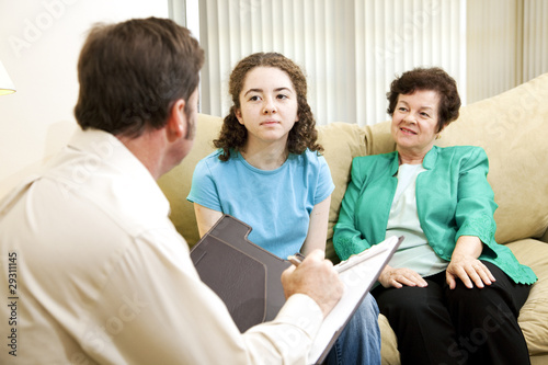 Teen and Mom Meet Psychologist