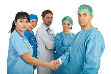 Physician woman and surgeon man handshake