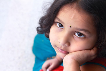 Cute Indian Little Girl Looking Up