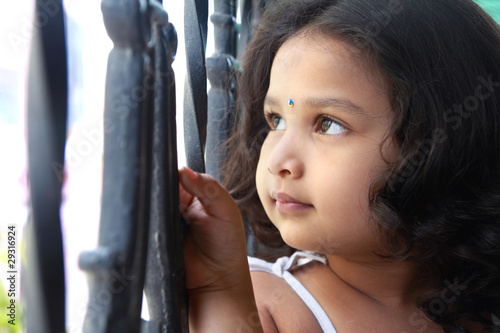 Cute Indian Girl Looking up With Smile