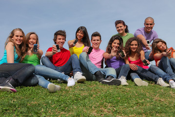 group of kids or teens with mobile or cell phones