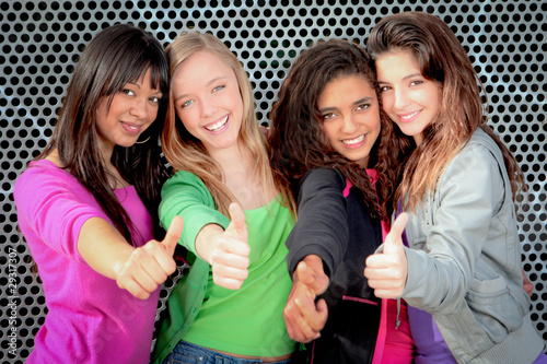group of diverse teens girls with thumbs up