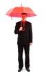 Businessman with red umbrella