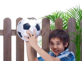 smiling boy returning football to the neighbors
