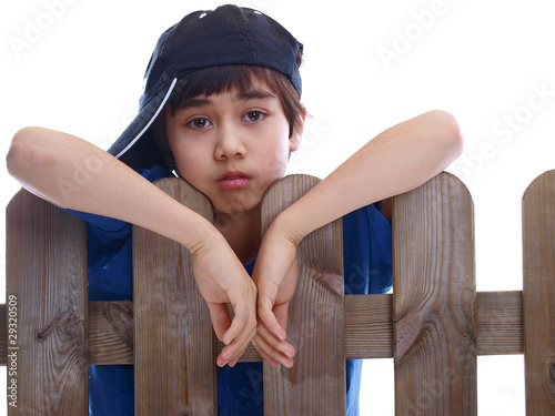 child looking over a fence