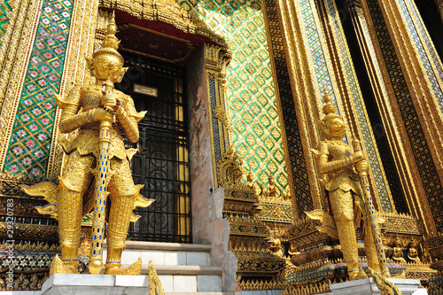 The golden giant statue in Wat Phra Kaew, Bangkok Thailand.