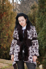 Sad pretty girl in fall park
