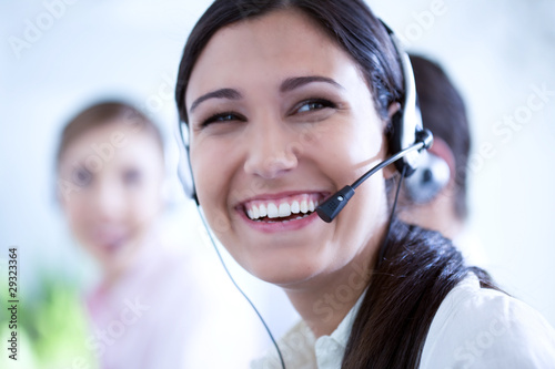 Happy woman in a call center