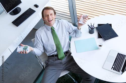 Happy businessman with euros