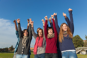 Happy College Students with Thumbs Up.