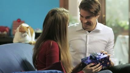 man giving present to girlfriend
