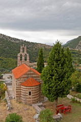 red roofed little church in the mountains of Montenegro