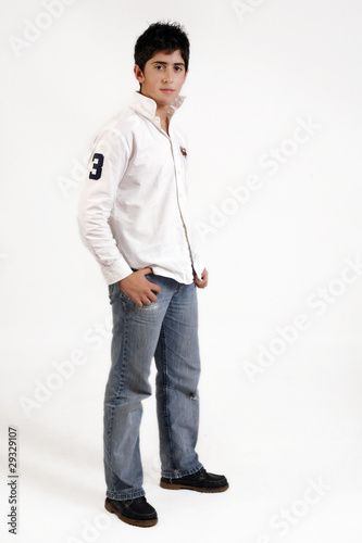 teenage boy in jeans and white shirt