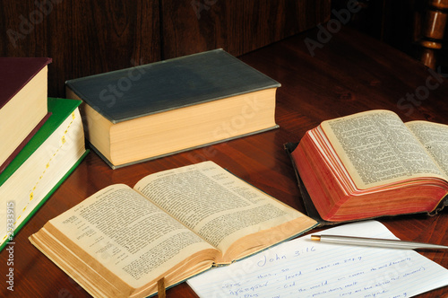 Greek and English Bibles open to John with study aids