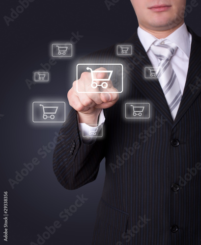 Man pressing shopping cart icon