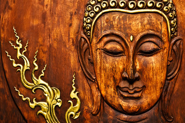 Buddha image in Thai style wood carving