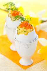 Scrambled egg with chives and red caviar