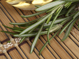 fresh rosemary with warm massage oil