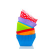 a pile of colorful cupcake molds isolated over white