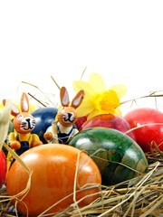 Shiny easter eggs & bunny decorations on a grass background