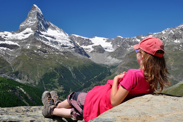 girl looking at the Matterhorn in the Swiss Alps