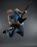 Fototapety passionate guitarist jumps in the ai