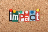 The word Impact in magazine letters on a notice board poster