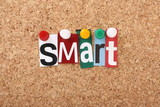 The word Smart in magazine letters on a notice board poster