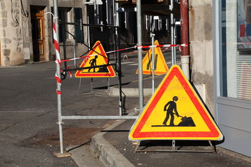 Warning Hazard Signs Under Scaffolding On Street