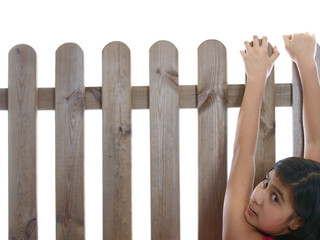 teenage girl climbing over the fence
