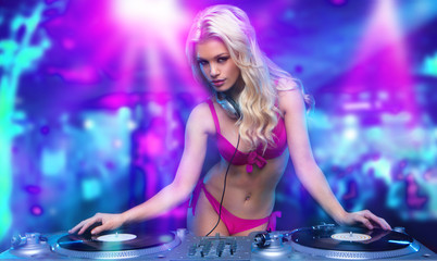 sexy blonde dj girl  in the club