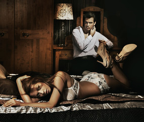 Two adult people in bedroom posing