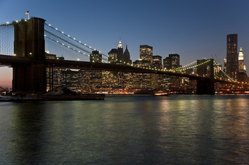 Brooklyn Bridge and Manhattan skyline at dusk (New York City)