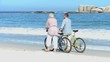 Aged couple walking with bikes