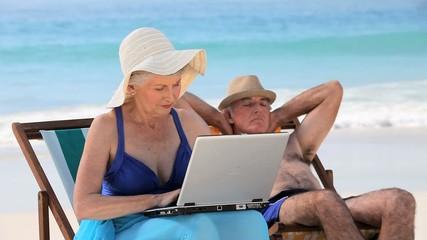Elderly woman working on the laptop
