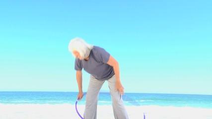 Elderly woman doing a hula hoop