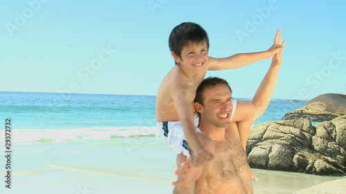 Man carrying his son on his shoulders