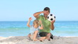 Man and his son playing with a soccer ball