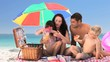 Cute family having a picnic on the beach