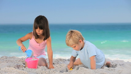 Children building a sand castle