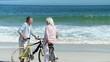 Senior couple with bikes talking each other