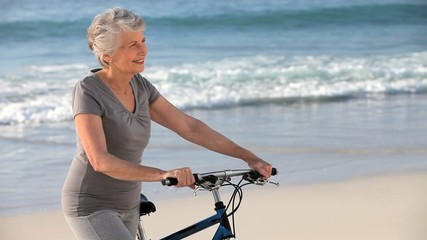 Mature woman waiting with a bike