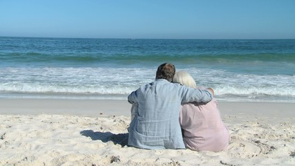 Elderly couple looking at the ocean