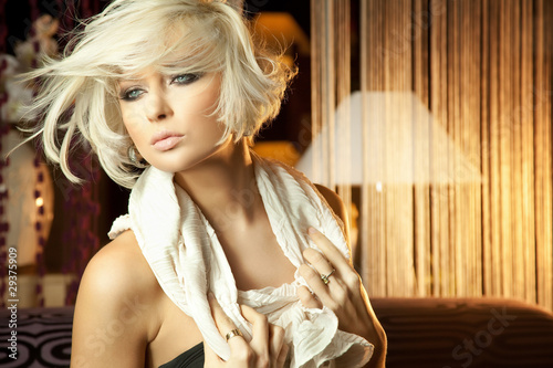 Calm portrait of amazing blond woman with blue eyes
